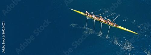 Fotografia, Obraz Aerial drone ultra wide photo of team of fit women practising in sport canoe in