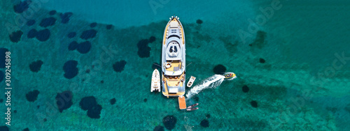 Vászonkép Aerial drone ultra wide photo of luxury yacht docked in tropical exotic island w