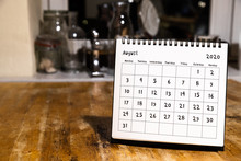 August 2020 Calendar - Month Page On Wooden Table In The Kitchen