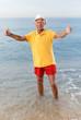 Nice satisfied mature man posing near ocean
