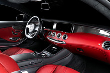 Red Luxury Modern Car Interior With Steering Wheel, Shift Lever And Dashboard. Clipping Path. Detail Of Modern Car Interior. Automatic Gear Stick. Part Of Leather Seats With Stitching In Expensive Car