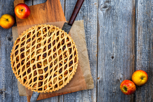 Traditional apple jalousie cake offered as top view on a modern design wooden board with copy space