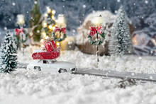 Miniature Classic Car Carrying A Christmas Gifts On Snowy Winter Landscape