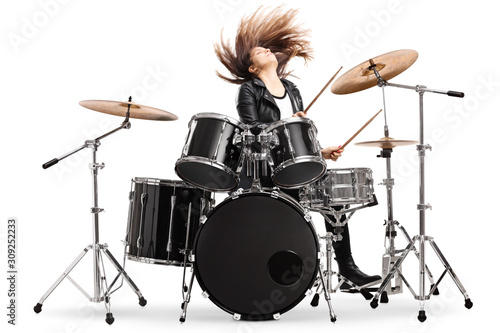 Fotografiet Energetic female drummer throwing her hair and playing drums