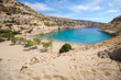 The small isolated gulf of Vathi, in Crete, with sandy beach and some lucky campers.