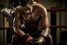 Tired Male Boxer Sitting In Bo...