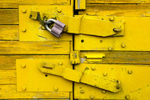 Vivid Old Yellow Wooden Locked...