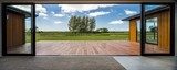 Fototapeta Fototapety z naturą - View from a modern house with big glass doors looking at the green field