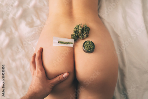 Fototapeta jon ass themed weed and sex Weed and Cannabis oint on the girl's Men's Hand obraz