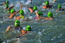 Women's Triathlon Swimming Leg, All Wearing Green Caps