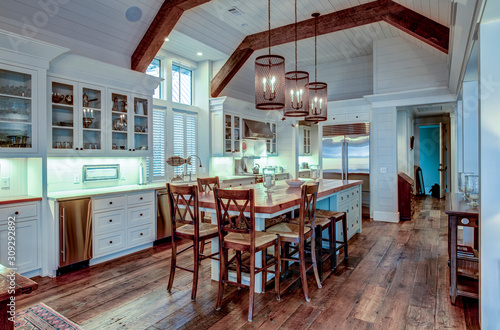 Fényképezés Large expensive chefs kitchen in luxury home with rough hewn wood and white cabinets