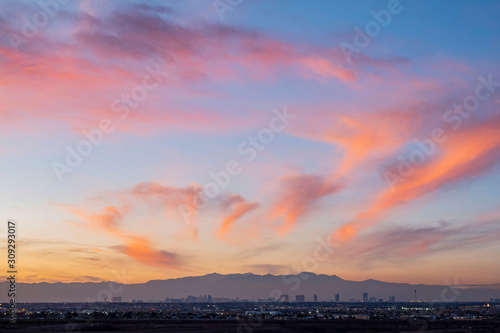 Spoed Foto op Canvas Las Vegas Sunset aerial view of the strip with mountain behind