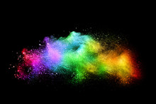 Explosion Of Colored Powder Isolated On Black Background. Abstract Colored Background. Holi Festival.