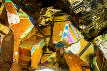 Exteme Macro With 10x Magnification Of A Pyrite Surface. The Mineral Pyrite Also Known As Fool's Gold, Is An Iron Sulfide Usually Found Associated With Other Sulfides Or Oxides In Quartz Veins.