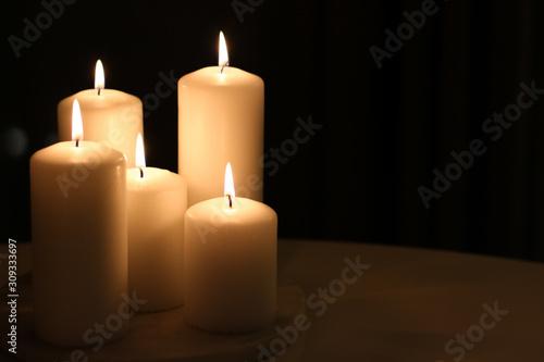 Fototapeta Aromatic vanilla yellow candles set at night, Christmas, New Years and holidays background, Valentines Day luxury home decor and holiday season brand design obraz na płótnie