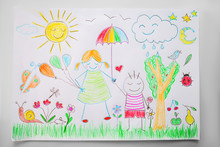 Child Drawing A Happy Family With Color Pencils
