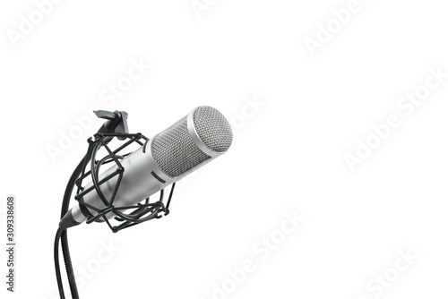High quality condencer microphone with clipping path. Close up of high fidelity microphone hanging  on holder isolated on white background for youtuber and vlogger. #309338608