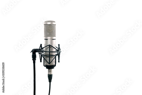 High quality condencer microphone with clipping path. Close up of high fidelity microphone hanging  on holder isolated on white background for youtuber and vlogger. #309338609
