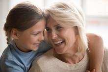 Loving Granddaughter Hug Happy Grandmother Enjoying Time Together
