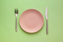 Empty Pink Plate With Utensils...