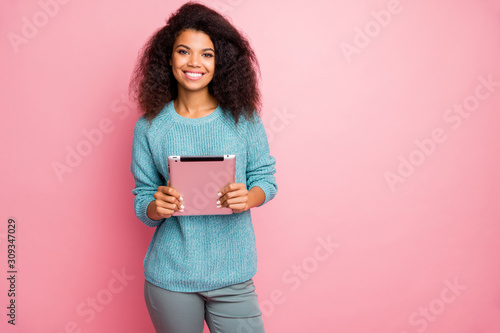 Portrait of her she nice-looking attractive lovely charming pretty cheerful cheery wavy-haired girl holding in hands tablet working remotely isolated over pink pastel color background - 309347029