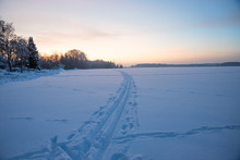 Cross-country Ski Trail On Snowy Field, Winter Landscape At Sunset