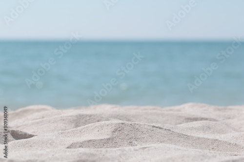 Beautiful sand dunes on a blurred sea background. Outdoor nature