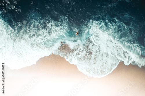 Aerial view of couple playing on beach - 309360275