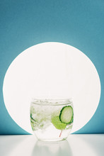 Fresh Gin And Tonic With Cucumber Slices On Blue Background With Back Light