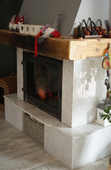 marble fireplace with a wooden beam decorated with Christmas decorations