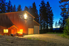 Large Metal Barn At Night With...