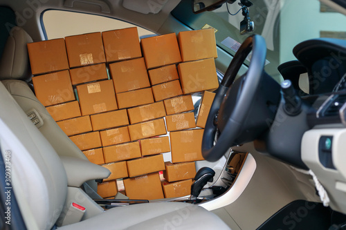fototapeta na szkło paper box post package of product full in car preparing delivery for customer order, image used for shipment logistic business concept
