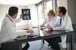 Medical team looking at Xray during meeting
