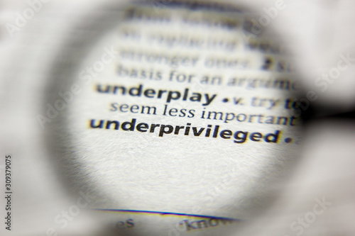 The word or phrase Underprivileged in a dictionary. Fototapeta