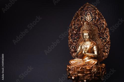 Statue of bronze of Bodhisattva Guan Yin (Avalokiteshvara) sitting in the lotus position, having put hands in knowledge-mudra Wallpaper Mural