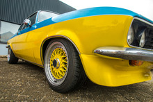Low Angle View Of A Yellow Classic Car At A Classic Car Meeting