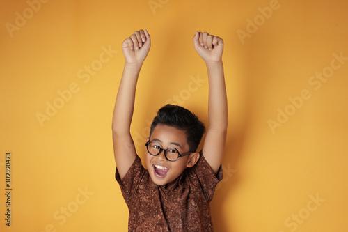 Canvastavla Smart Asian Boy Shows Winning Gesture