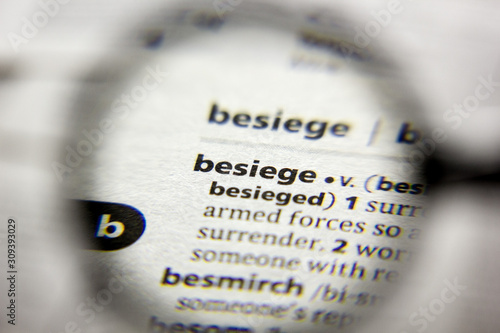 Photo The word or phrase Besiege in a dictionary.