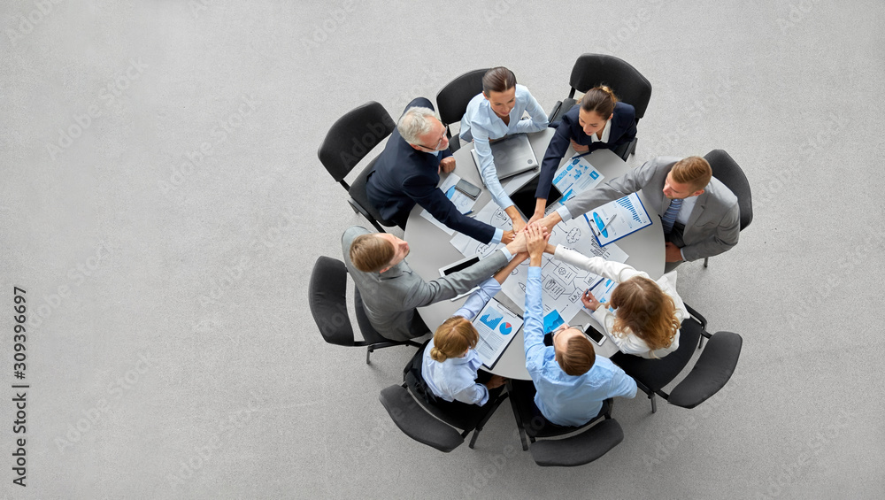 Fototapeta corporate, people and teamwork concept - happy business team stacking hands
