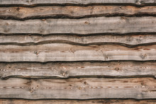 Wooden Fence Made Of Overlapped Planks With Raw Edges. Rustic Background And Texture