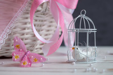 Dummy Of Small White Bird Locked In Cage Among The Beautiful Interior In Pink Tones. Reflections On Happiness And Freedom. Selective Focus