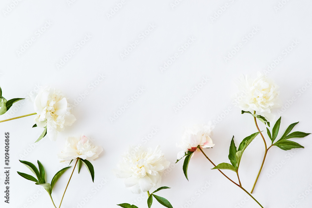Fototapeta Flat lay pattern with white peonies on a white background