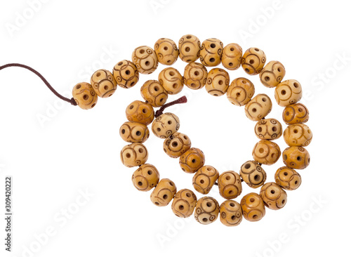 spiral string of carved bone beads isolated Fototapet