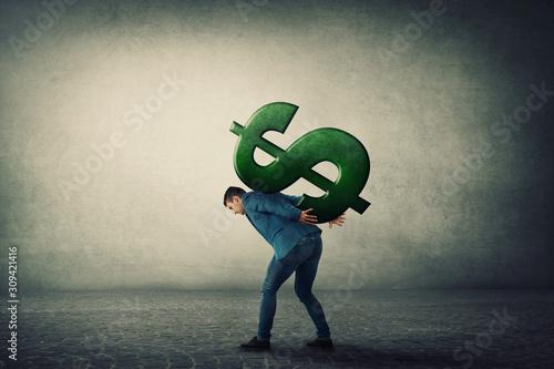 Vászonkép Businessman carrying a big american dollar sign on his back