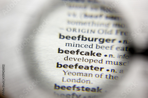 Photo The word or phrase Beefcake in a dictionary.