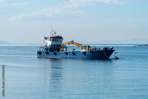 Vászonkép Dredge ship in the harbor of Carril, Pontevedra, Spain
