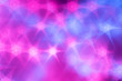 canvas print picture - Splash of blue and pink sparkles on black background.