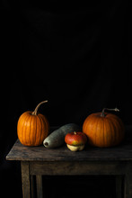 Pumpkin Still Life On A Wooden...