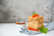 Classic Thin Lace Pancakes On A Wooden Plate With Red Caviar On A Light Background. A Traditional Dish For Shrove Tuesday. Horisontal Photo With Copy Space