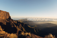 Drakensberg Mountains During The Sunrise With Massive Clouds And Sharp Cliffs